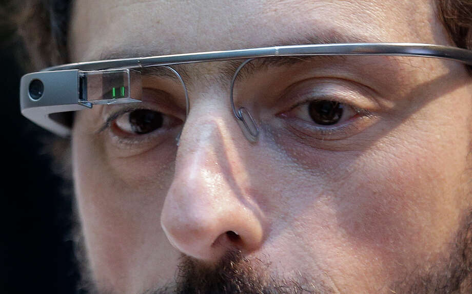 Google co-founder Sergey Brin wears a Google Glass device in 2013. Google says it will stop selling its Internet-connected eyewear to consumers until it can develop a more polished version. Photo: Jeff Chiu, STF / AP