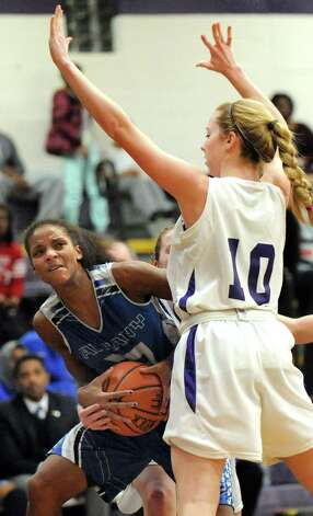 Albany's Mylah Chandler, left, works to get to the hoop as CCHS's Julia Engster defends during their basketball on Thursday, Jan. 15, 2015, at Catholic Central High School in Troy, N.Y. (Cindy Schultz / Times Union) Photo: Cindy Schultz / 00030165A