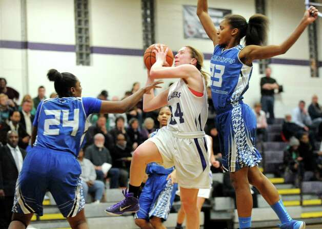 CCHS's Taylor Engster, center, goes to the hoop as Albany's Shayona Foulks, left, and Mylah Chandler defend during their basketball on Thursday, Jan. 15, 2015, at Catholic Central High School in Troy, N.Y. (Cindy Schultz / Times Union) Photo: Cindy Schultz / 00030165A
