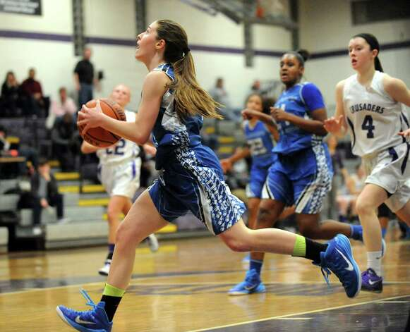Albany's Bridget Whelan, center, breaks away and closes in on the basket during their basketball against CCHS on Thursday, Jan. 15, 2015, at Catholic Central High School in Troy, N.Y. (Cindy Schultz / Times Union) Photo: Cindy Schultz / 00030165A