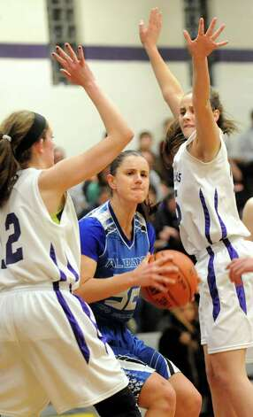 Albany's Leah Dollard, center, controls the ball as CCHS's Emilie Benton, left, and Hannah Field defend during their basketball on Thursday, Jan. 15, 2015, at Catholic Central High School in Troy, N.Y. (Cindy Schultz / Times Union) Photo: Cindy Schultz / 00030165A