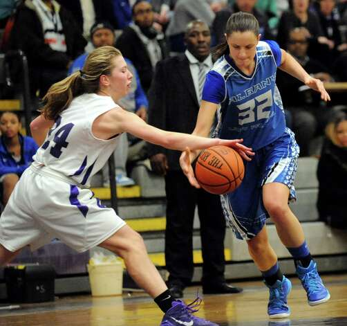 Albany's Leah Dollard, right, controls the ball as CCHS's Taylor Engster defends during their basketball on Thursday, Jan. 15, 2015, at Catholic Central High School in Troy, N.Y. (Cindy Schultz / Times Union) Photo: Cindy Schultz / 00030165A