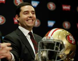 Niners CEO Jed York reacts during a press conference to announce the promotion of Jim Tomsula to head coach. York spoke Friday in Arizona about how the offense, and quarterback Colin Kaepernick in particular, could be much improved next season.