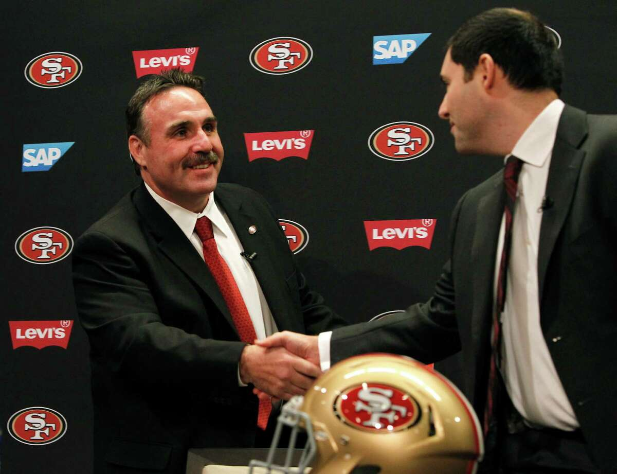 Jim Tomsula shakes hands with team CEO Jed York after Tomsula is introduced as the new head coach of the San Francisco 49ers during a press conference at Levi's Stadium in Santa Clara, Calif. on Thursday, Jan. 15, 2015.