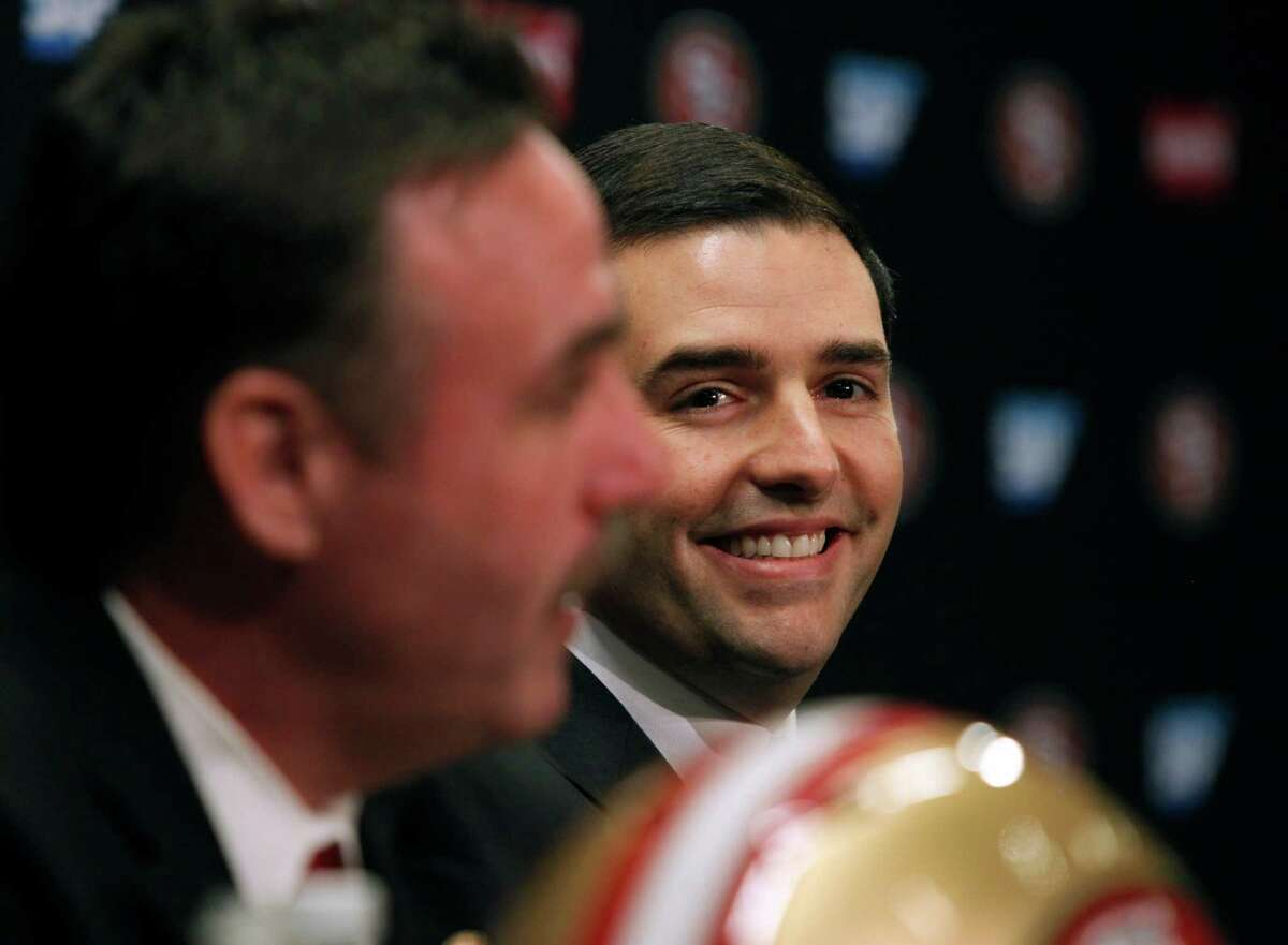Team CEO Jed York smiles after naming defensive line coach Jim Tomsula (left) as the new head coach of the San Francisco 49ers during a press conference at Levi's Stadium in Santa Clara, Calif. on Thursday, Jan. 15, 2015.