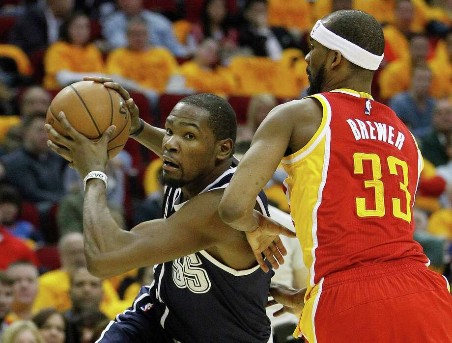 Although Kevin Durant, left, got on an offensive roll as the game progressed, the Thunder star could not find a way to carry his team past Corey Brewer and the Rockets on Thursday night at Toyota Center. Photo: Karen Warren, Staff / © 2015 Houston Chronicle