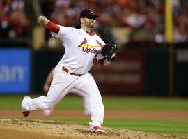 Starting pitcher Lance Lynn re-signed with the Cardinals for three years and $22 million.