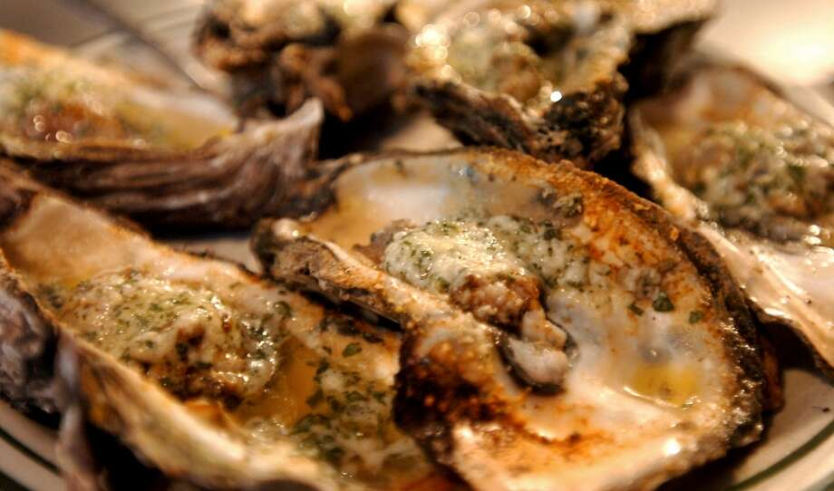 Flame grilled oysters are available at Floyd's in Beaumont, Tuesday, January 4, 2012. Tammy McKinley/The Enterprise