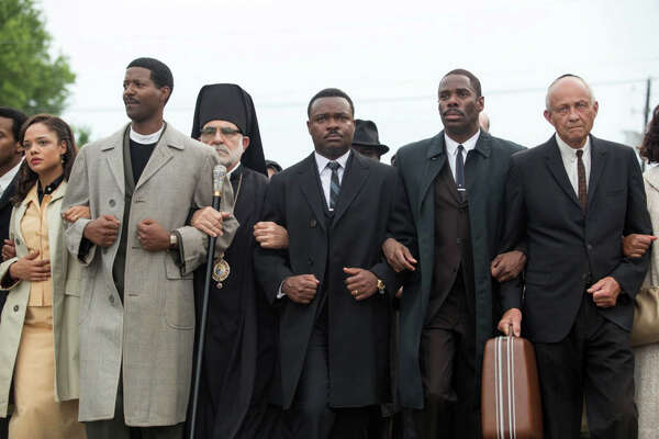 "Rev. Dr. Martin Luther King Jr., portrayed by David Oyelowo, center, leads a civil-rights march in the new movie, ""Selma."""