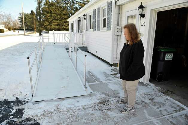 Joanne Sajta stands outside her home next to the wheelchair ramp on Thursday, Jan. 8, 2015, in Hagaman, N.Y.   The VA had the ramp installed for her husband Peter who needs a wheelchair.  Joanne and Peter say that the ramp and its construction has problems.  (Paul Buckowski / Times Union) Photo: Paul Buckowski / 00030106A