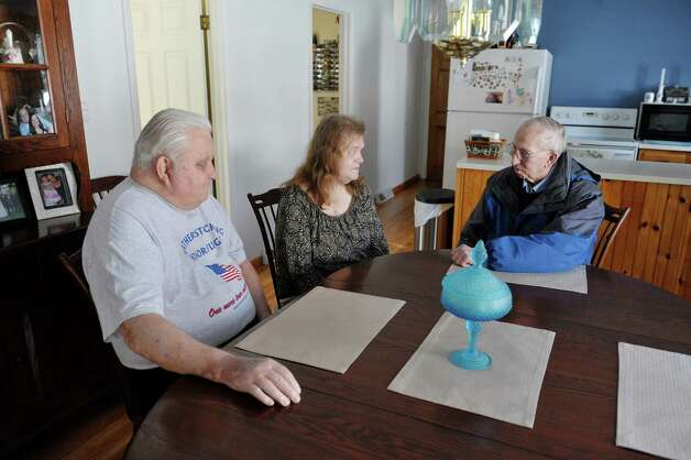 Peter Sajta, left, and his wife, Joanne Sajta talk with Paul DuBois, with Mountains to Miracles Veteran's Foundation at their home on Thursday, Jan. 8, 2015, in Hagaman, N.Y.    DuBois is helping Peter, a Veteran, to get the benefits he's supposed to get from the VA.  (Paul Buckowski / Times Union) Photo: Paul Buckowski / 00030106A