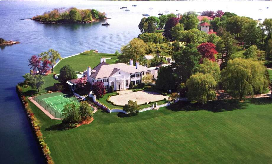 An aerial photo of the home that was once owned by Donald Trump at 21 Vista Drive in Greenwich, Conn., Thursday, Jan. 15, 2015,  is now on the market with an asking price of $54 million. The waterfront mansion sits on roughly 6 acres of land near the tip of Indian Harbor Point on Long Island Sound. Photo: Bob Luckey, Contributed / Greenwich Time