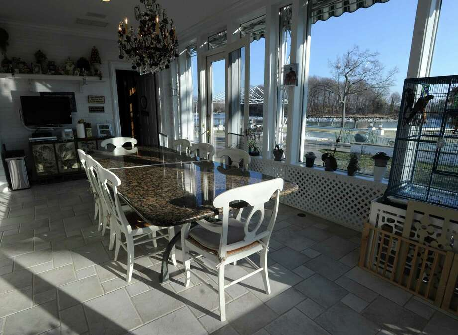 A dining area with a view of L.I. Sound in the home that was once owned by Donald Trump at 21 Vista Drive in Greenwich, Conn., Thursday, Jan. 15, 2015,  is now on the market with an asking price of $54 million. The waterfront mansion sits on roughly 6 acres of land near the tip of Indian Harbor Point. Photo: Bob Luckey / Greenwich Time