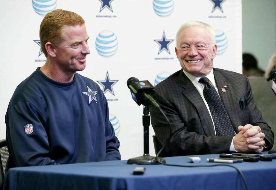Dallas Cowboys head coach Jason Garrett, left, smiles as team owner Jerry Jones responds to questions about Garrett's five year contract extension during a news conference at the teams headquarters, Thursday, Jan. 15, 2015, in Irving, Texas. Scott Linehan is returning to the Cowboys along with coach Garrett and will add the title of offensive coordinator after one season as Tony Romo's play-caller. Photo: Tony Gutierrez /Associated Press / AP