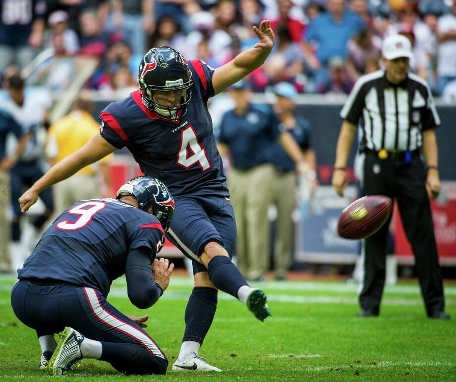 Houston Texans kicker Randy Bullock kicks an extra point from the hold by punter Shane Lechler during the first quarter of an NFL football game against the Tennessee Titans at NRG Stadium on Sunday, Nov. 30, 2014, in Houston. ( Smiley N. Pool / Houston Chronicle ) Photo: Smiley N. Pool, Staff / © 2014  Houston Chronicle