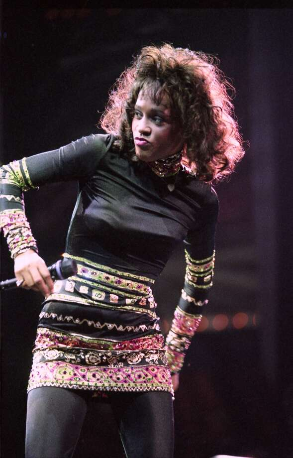 08/25/1994 - Singer Whitney Houston performs at the Houston Summit as part of The Bodyguard World Tour. Photo: Paul S. Howell, © Houston Chronicle