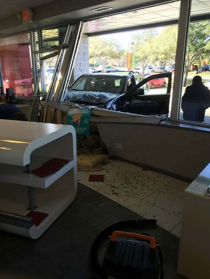 Reddit user Ebonicalmisfit shared these photos with the online community of a Jeep crashing through the dealership Thursday afternoon. Photo: Imgur.com