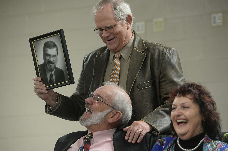 Orange County judge Carl Thibodeaux and wife Micaela Thibodeaux react as friend and district judge Pat Clark surprises him with an old photo while making remarks at his retirement party Thursday. Thibodeaux famously served on the judiciary in Orange County for 20 years.