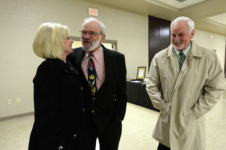 Orange County judge Carl Thibodeaux talks with district judges Courtney Arkeen (left) and Buddie Hahn during his retirement party Thursday. Thibodeaux famously served on the judiciary in Orange County for 20 years.