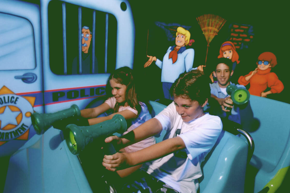 Six Flags Fiesta Texas visitors aim for ghosts and other scary targets at Scooby-Doo Ghostblasters.