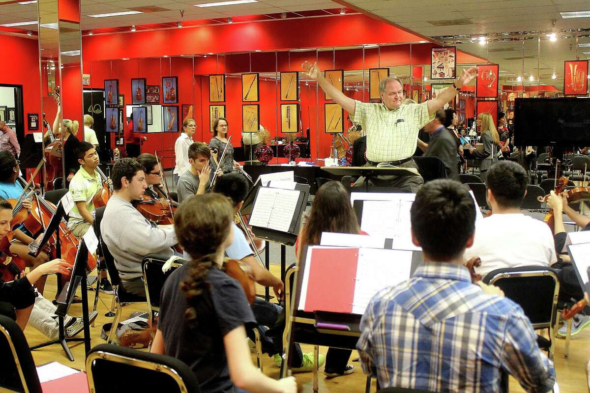 Maestro Andrzej Grabiec rehearses the Virtuosi of Houston Youth Orchestra at their studio in Memorial City Mall.