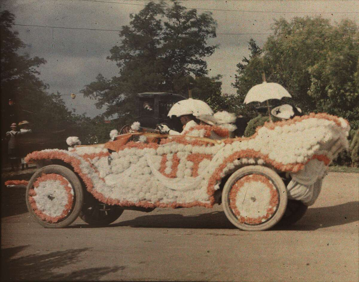 This photo from 1910-1920 shows a decorated automobile in a University of Texas parade.