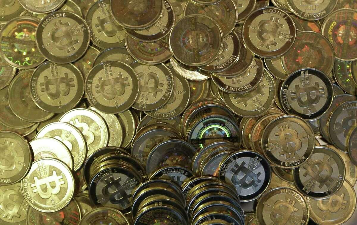 FILE - This April 3, 2013 file photo shows bitcoin tokens in Sandy, Utah. (AP Photo/Rick Bowmer, File) ORG XMIT: TOK110