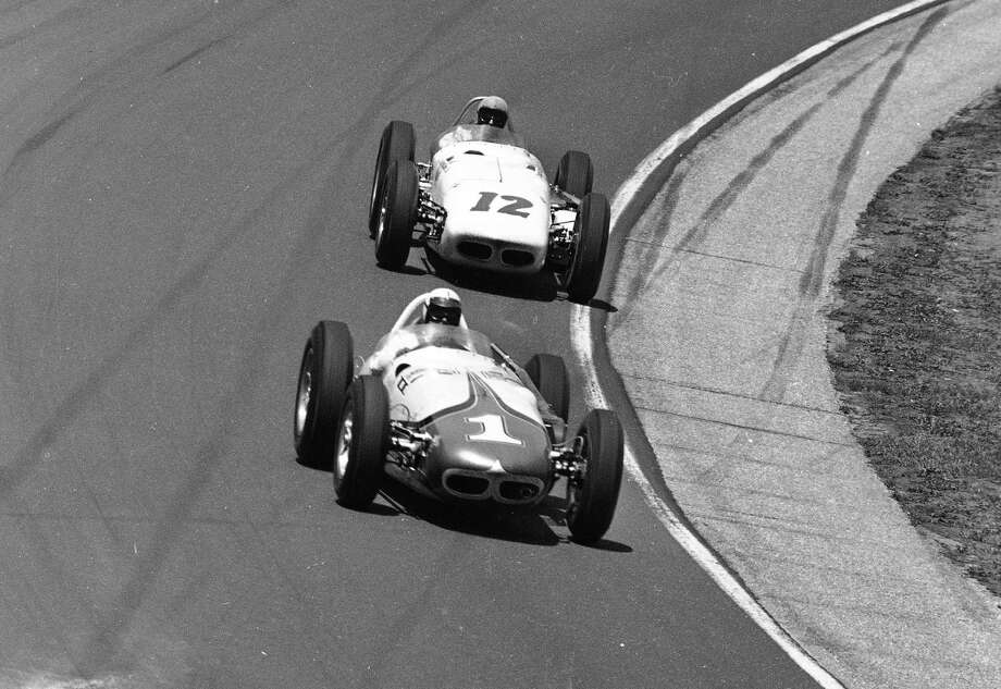 May 30, 1961 -- A.J. Foyt in the Bowes Seal Fast Special (1), has a few seconds lead on Eddie Sachs, in the Dean Van Lines Special (12) as they are negotiate a curve at the Indianapolis Motor Speedway during the 500-mile Memorial Day Classic. Foyt took the green flag at the Indianapolis 500 for the first time 50 years ago and wasn't sure he ever wanted to come back. Photo: Anonymous, AP / AP