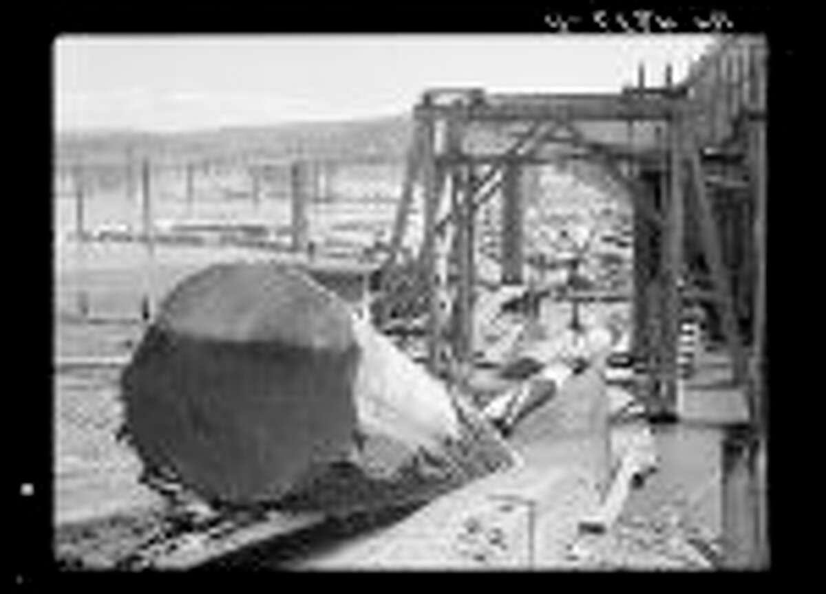 Logs coming up conveyor into mill. Longview, Wash., July 1936.
