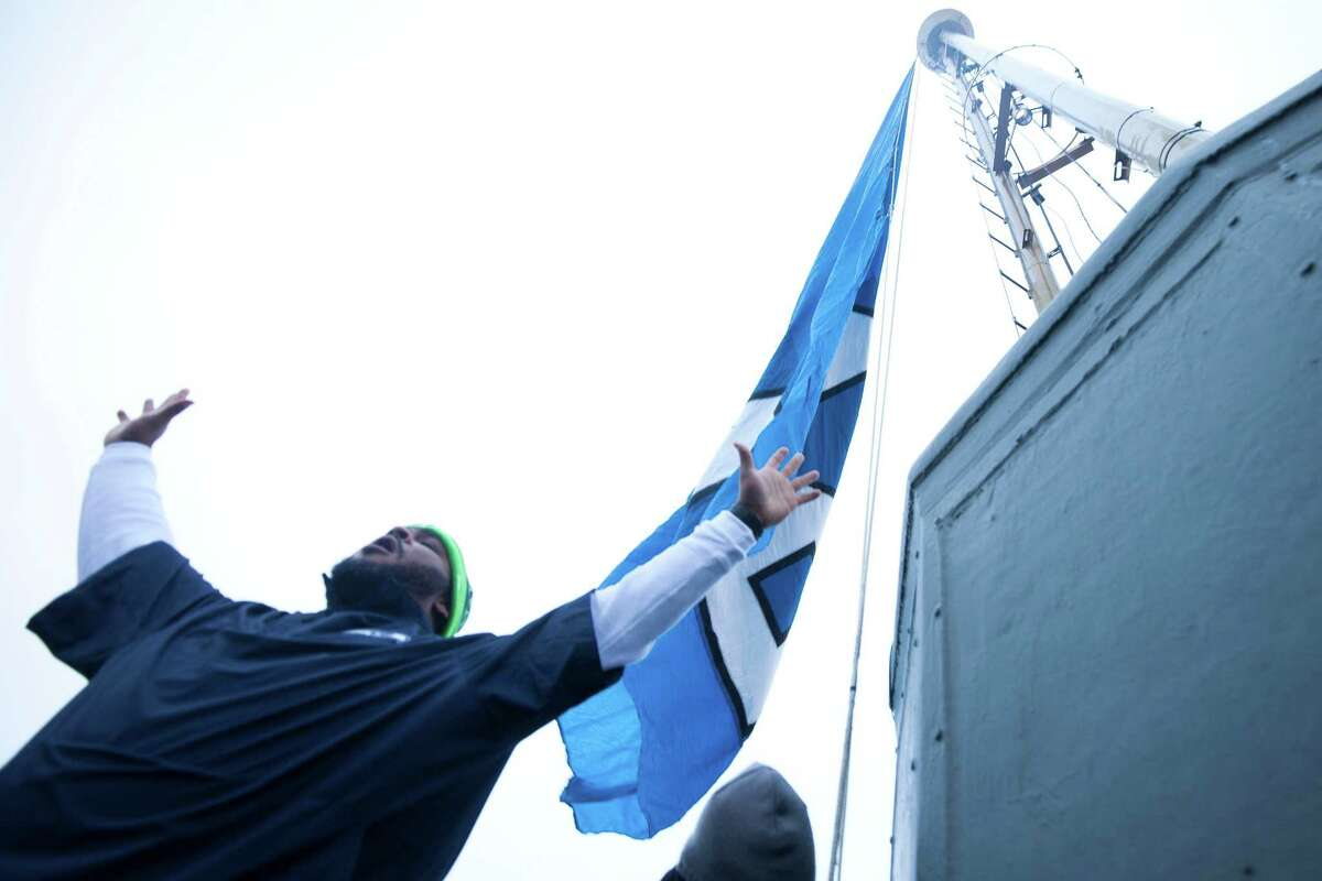 Former Seahawks player Walter Jones had the honor of raising the 12th man flag on top of the Space Needle in celebration for the Seahawks' upcoming NFC Championship game against the Green Bay Packers.