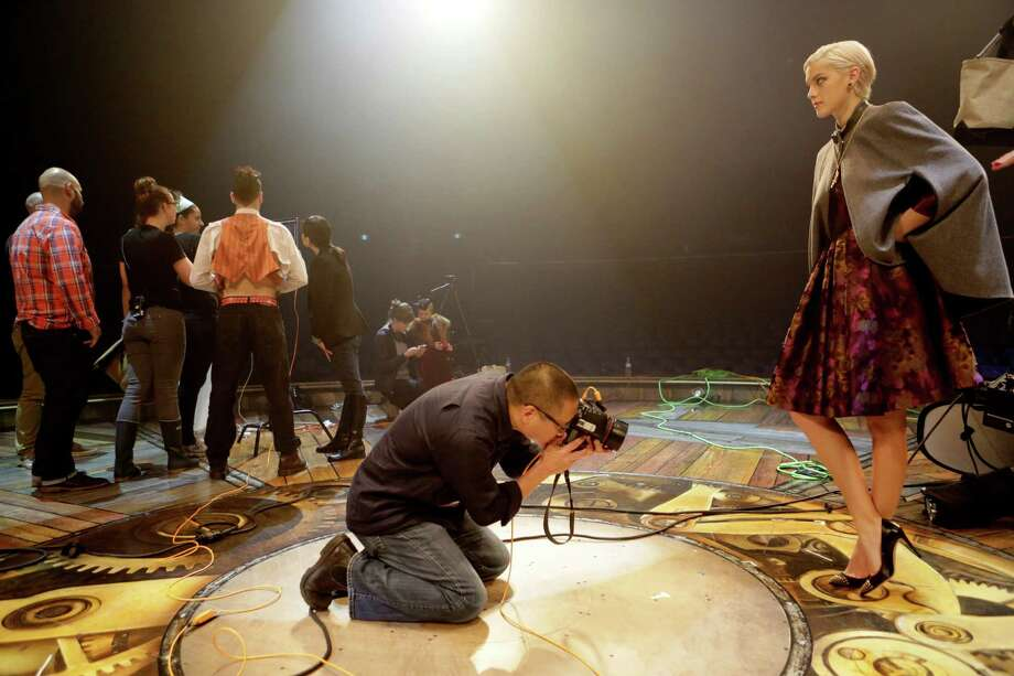 Photographer Russell Yip takes photos of shoes worn by model Amanda Pacheco during a shoot for the Chronicle's Style section at Cirque du Soleil in San Francisco on Tuesday, December 16, 2014. Photo: Terray Sylvester / The Chronicle / ONLINE_YES
