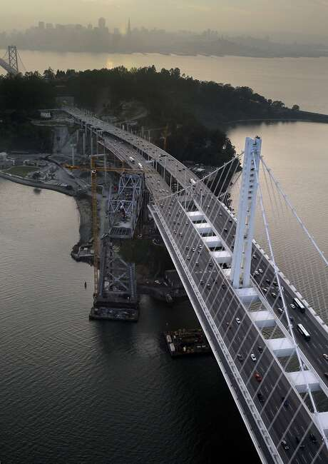 The Bay Bridge's novel, self-anchored suspension design is striking, but it came at a huge cost. Bridge experts were outvoted in picking the design by panel members with no bridge knowledge or experience. Photo: Carlos Avila Gonzalez, The Chronicle