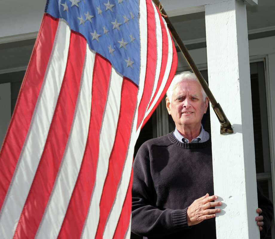 The newly sworn in Greenwich Selectman John Toner stands by the American Flag at his home in the Glenville section of Greenwich, Conn., Friday, Jan. 16, 2015. Photo: Bob Luckey / Greenwich Time
