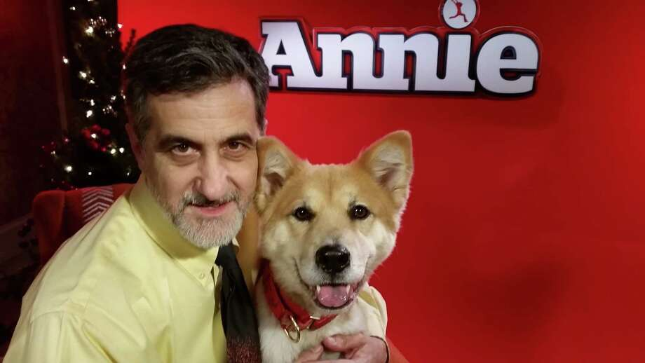 "Award-winning animal trainer Bill Berloni, who lives in Haddam, Conn., picked the latest ""Sandy,"" for the the new ""Annie"" movie from the Adopt-A-Dog shelter in Armonk, N.Y. Marti, pictured here with Berloni, had only been at the shelter for a few months when Berloni discovered her. The agency has been working to find new homes for animals since 1981, when it was started in Greenwich, Conn. Photo: Contributed Photo / Stamford Advocate Contributed photo"
