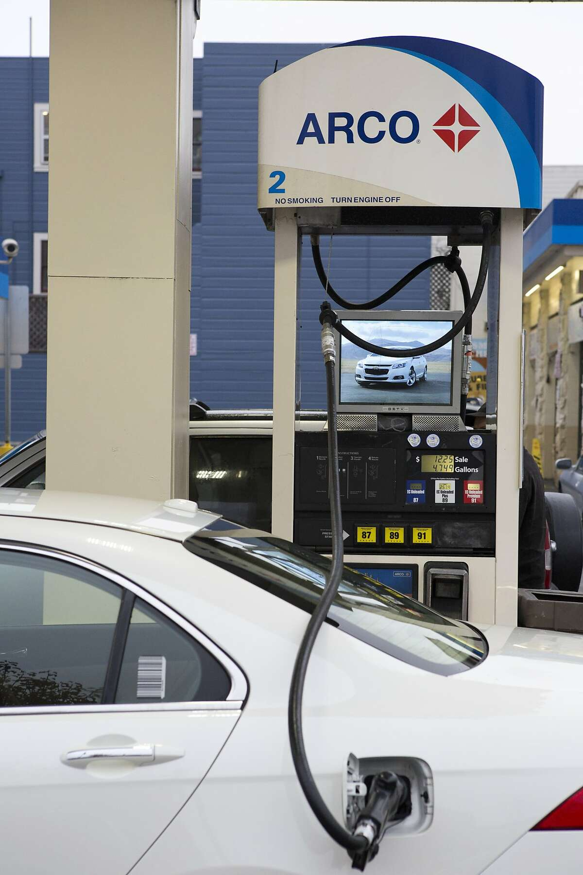 A customers gets gas at Arco on Divisadero St. on January 16, 2015 in San Francisco, Calif.