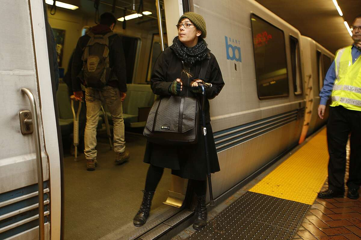 Female protester holding a cane blocked a northbound Bart train at the Montgomery Bart station in San Francisco, Calif., and was eventually arrested on Friday, January 16, 2015.