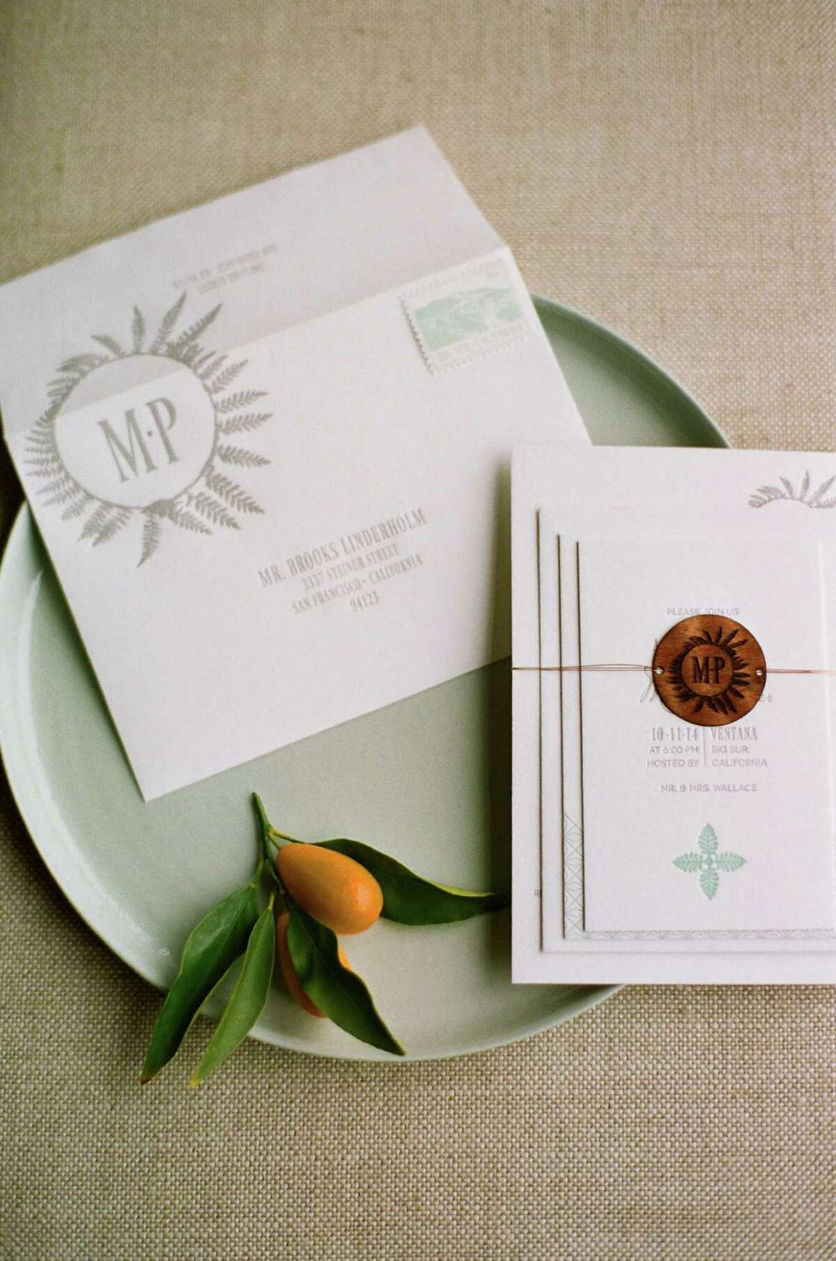 """An inviting brand Couples are using the visuals they develop for invitations and wedding collateral as personal branding elements, speaking to their heritage, relationship or venue. """"One client of ours was getting married under an oak tree. On the invite, we adhered a physical oak leaf that was dried and pressed,"""" says Julie Forsberg, co-owner of Yonder Design. Jill Velez, co-owner of Copper Willow Paper Studio, says icons like stylized personal crests can depict a blending of backgrounds and cultures. """"People really like having a defining image that they can relate to and is an expression of their personal style,"""" says Velez. Pictured: Wedding designs by Yonder Custom Event Design in San Francisco."""