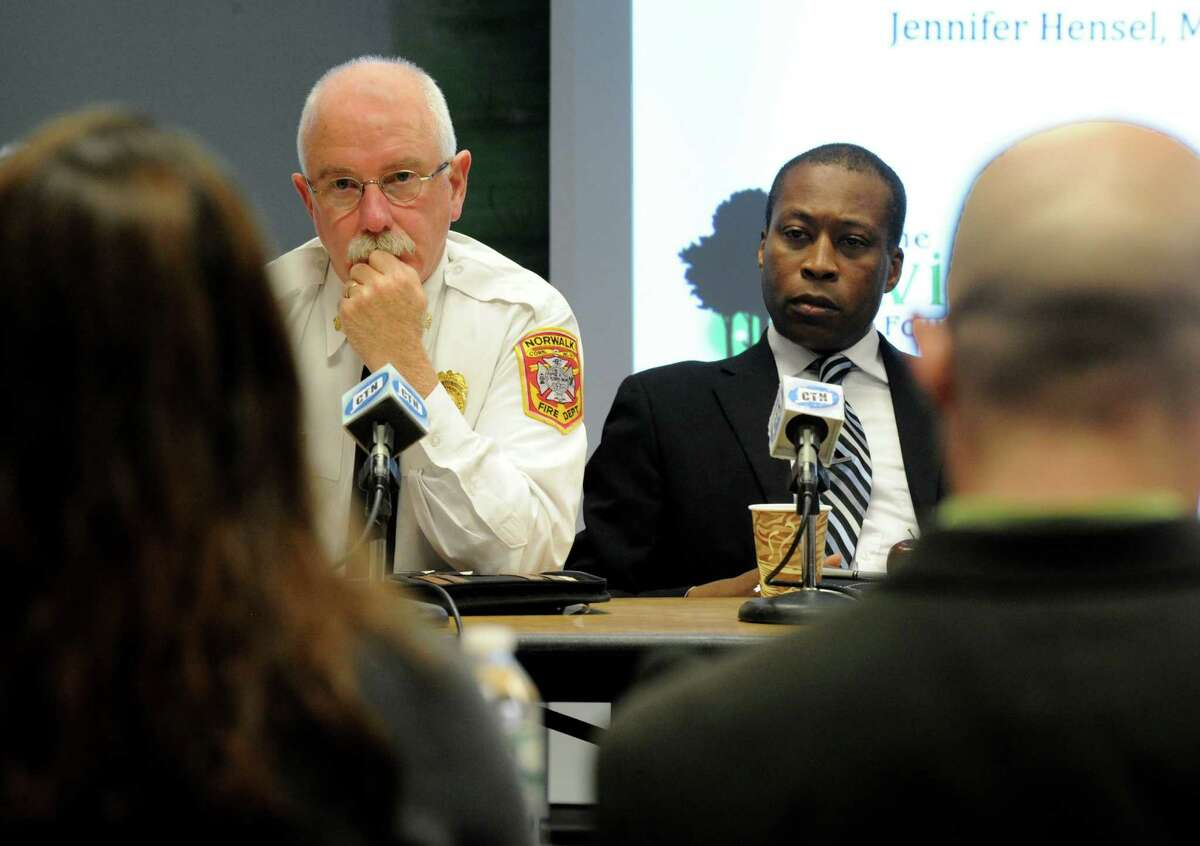 Sandy Hook Advisory Commission member and Norwalk Fire Chief, Denis McCathy, left and Scott Jackson, chairman, and other commission members reviewed final aspects of their study on Friday Jan. 16, 2015. The final recommendations will be released next month.