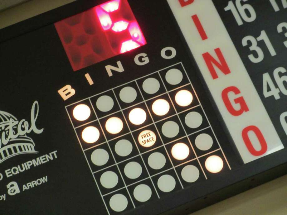 An electronic board on two walls of the Kickapoo Lucky Eagle Casino bingo hall helps players keep up with the numbers called for a variety of games with different jackpots. Photo: Terry Scott Bertling / San Antontonio Express-News