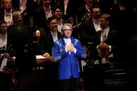 "Michael Tilson Thomas, in the blue jacket he received as a gift, basks as the audience sings ""Happy Birthday"" to him."