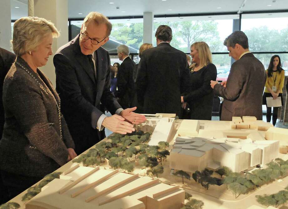 Museum of Fine Arts, Houston director Gary Tinterow uses a model by Steven Holl Architects to explain the institution's expansion plans to Mayor Annise Parker. Photo: Molly Glentzer
