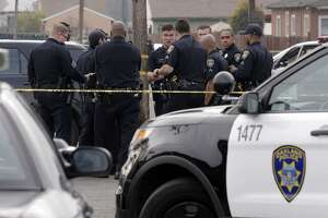 Oakland police investigate a double homicide in January. The department and the city attorney's office have done a poor job investigating officers accused of misconduct, a new report says.