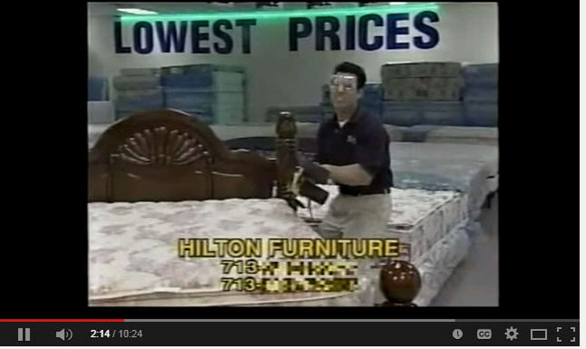 Hilton Koch wields a chainsaw to illustrate cutting prices in a commercial for Hilton Furniture. (YouTube)