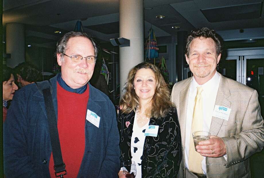 The 5th annual Authors Dinner in 2007 benefited the Berkeley Public Library Foundation. From left: Children's book author Robert San Souci with his sister-in-law Loretta San Souci and his brother and book collaborator, illustrator Daniel San Souci. Photo: Catherine Bigelow / The Chronicle / sfc