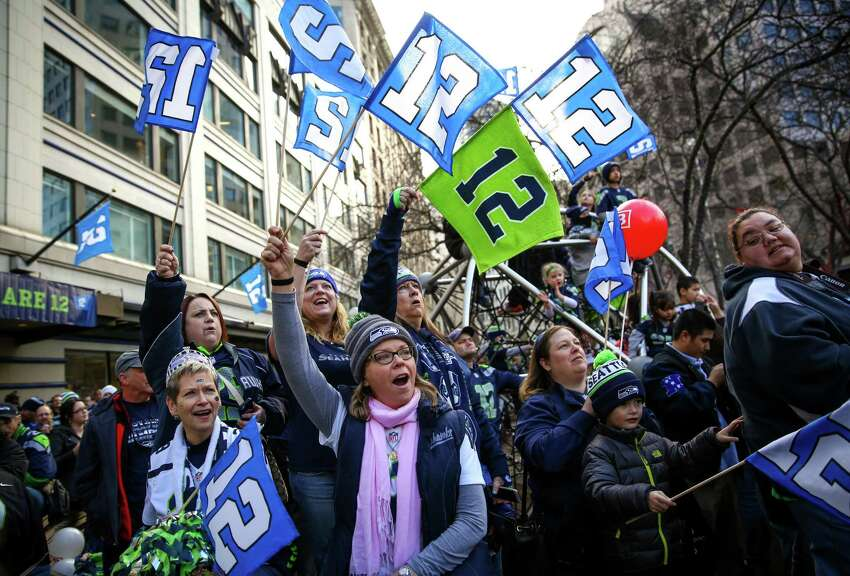 Fans cheer during a Seahawks rally at Westlake Park in advance of Sunday's NFC championship game against Green Bay. Hundreds of fans showed up to cheer for their team in advance of the big game. Photographed on Friday, January 16, 2015.