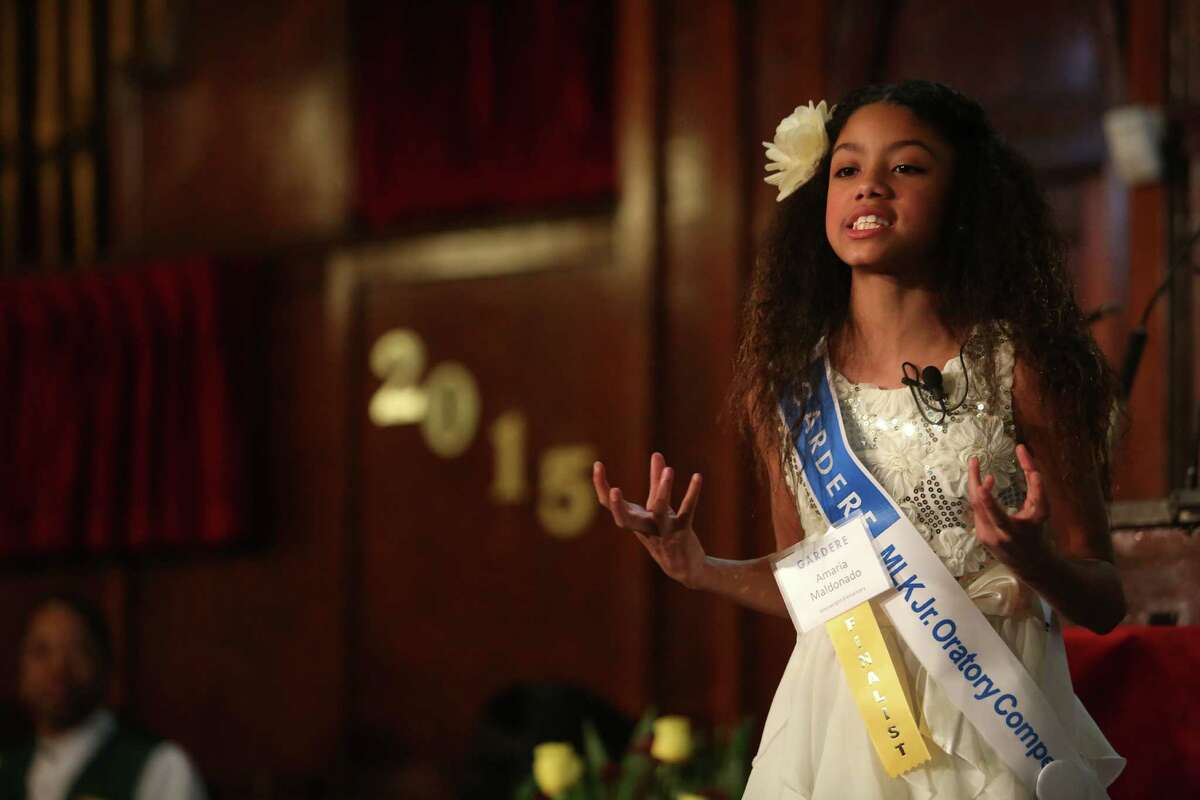 Amaria Maldonado, of Wainwright Elementary School, delivers her speech during the 19th annual Gardere MLK Jr. Oratory Competition sponsored by the Gardere Wynne Sewell LLP law firm at Antioch Missionary Baptist Church on Friday, Jan. 16, 2015, in Houston.