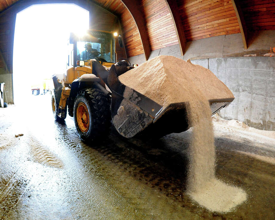 Plow trucks at the Connecticut D.O.T. facility in Trumbull, Conn. get loaded up with salt for the roads after a snow storm on Wednesday February 5, 2014. Photo: Christian Abraham / Connecticut Post