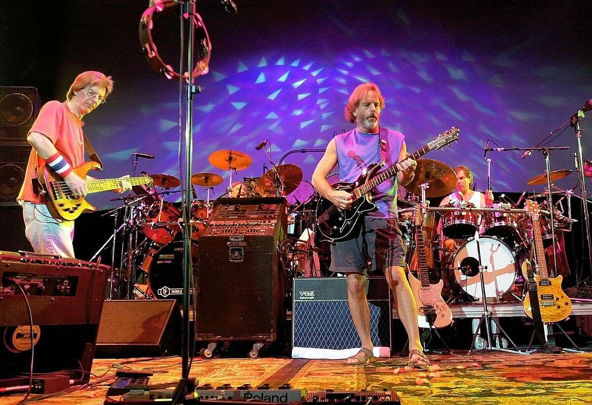 FILE - In this Aug. 3, 2002 file photo, The Grateful Dead, from left, Phil Lesh, Bill Kreutzmann, Bob Weir and Mickey Hart perform during a reunion concert in East Troy, Wis. he band announced Friday that original members Mickey Hart, Bill Kreutzmann, Phil Lesh and Bob Weir will perform three shows from July 3-5 at Soldier Field in Chicago. (AP Photo/Morry Gash, File)
