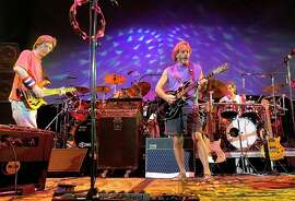 Bass player Phil Lesh (left), vocalist-guitarist Bob Weir and other original members of the Grateful Dead, shown in 2002, have scheduled three farewell shows in Chicago during the July 4 weekend.