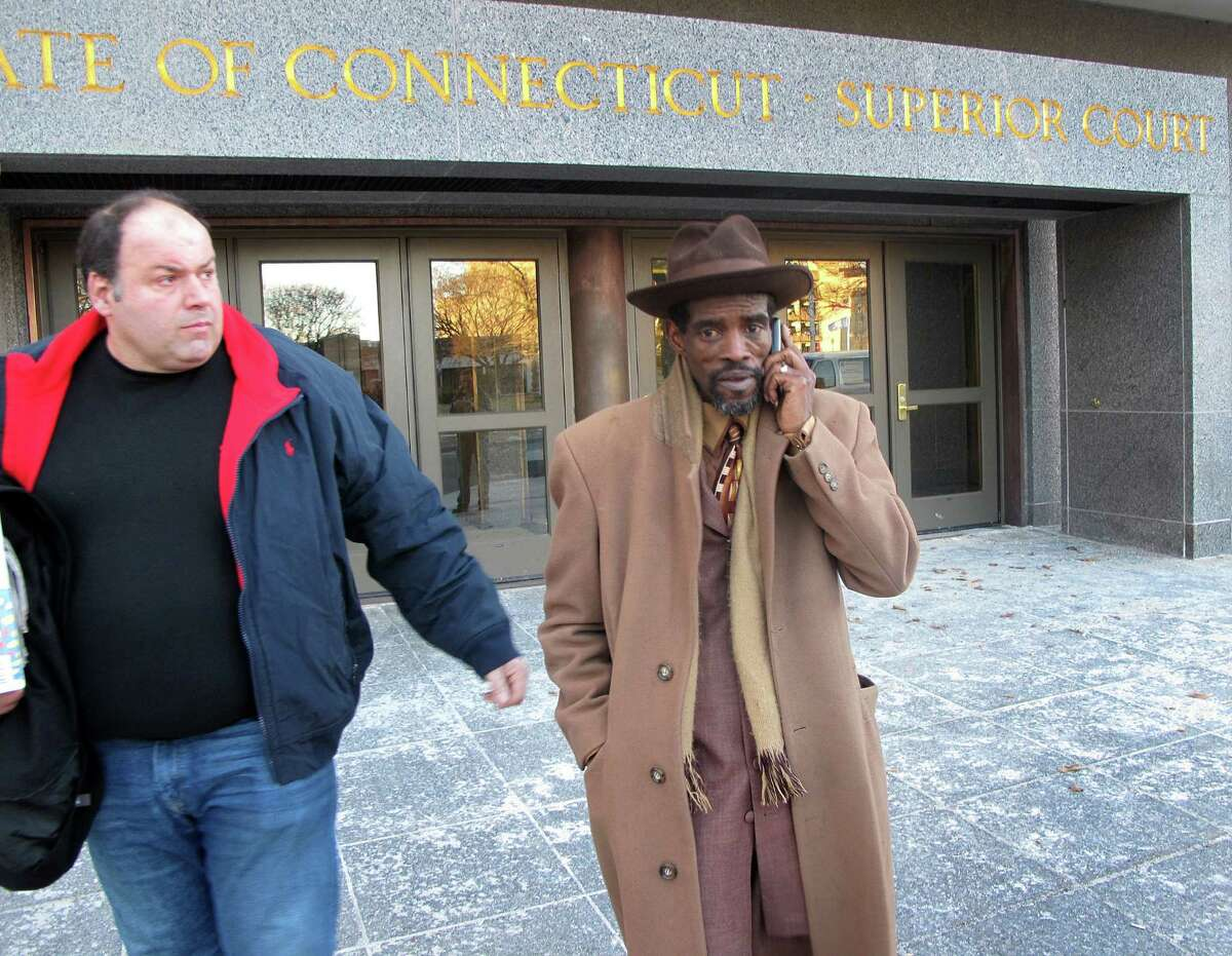 Former State Sen. Ernie Newton, right, exits Hartford Superior Court on Friday, Jan. 16, 2015. Newton was found guilty on three charges of illegal practices in campaign financing and acquitted on a charge of tampering with a witness. The jury was unable to reach a verdict on four other charges--two more counts of illegal practices in campaign financing and two counts of first-degree larceny. With Newtown is his friend, Chris Taylor.